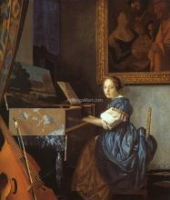 A Young Woman Seated at a Virginal - Johannes Vermeer